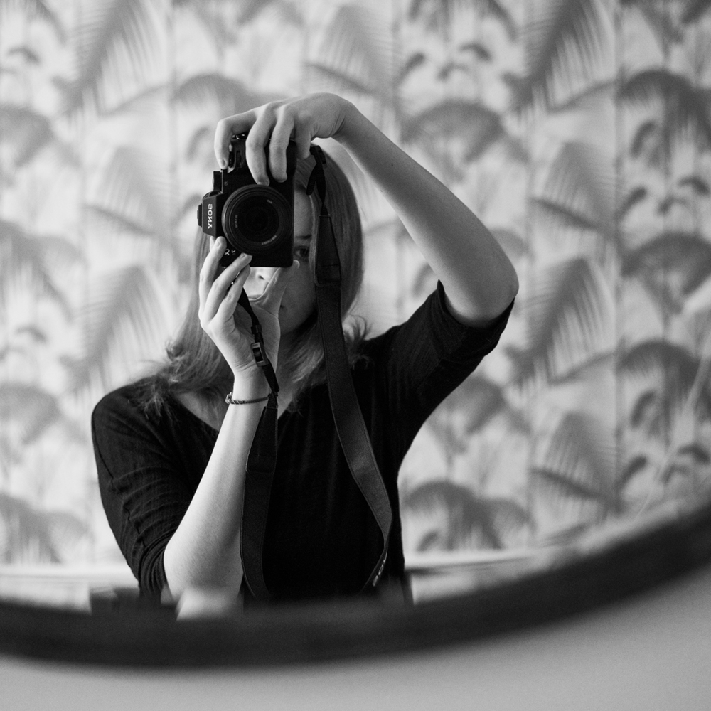 ELENA HELFRECHT black and with camera self portrait in front of a mirror