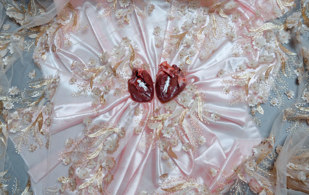 Open heart over a fancy dress